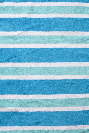 Worn beach towel background with wrinkles and horizontal lines. Stock Photo