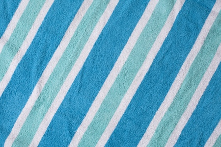Cool color beach towel background with diagonal lines.  photo