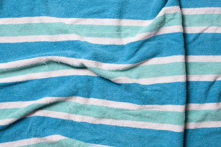 Old wrinkled beach towel background.