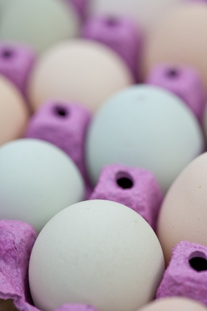 egg carton: Close up of natural organic eggs in a crate. Stock Photo