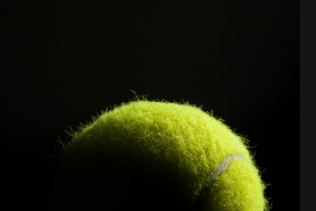 fuzz: Dramatic lighting on a tennis ball resembling the world from space  Concept is the world of tennis
