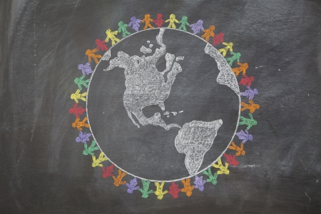 hand holding world: A hand drawn chalkboard shows multi-ratial people holding hands around the world to show care for the earth, peace, and unity Stock Photo