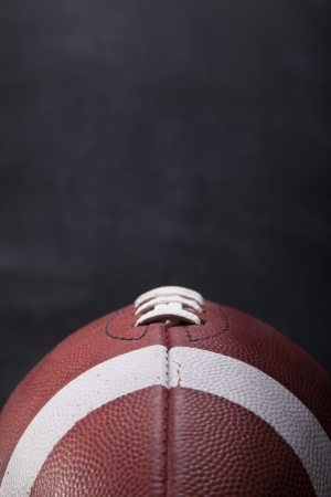 string together: An American football with a chalkboard in the background for copy-space  Stock Photo