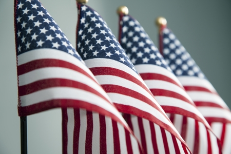 veterans: Four American flags stand in a row  Stock Photo