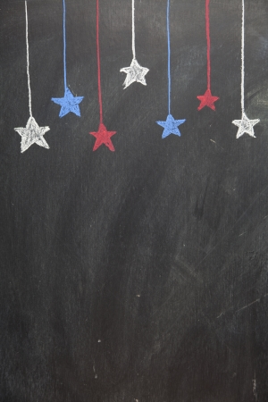 top seven: Seven patriotic stars hang from the top of a chalkboard Stock Photo