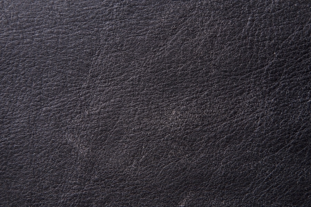 A close up texture of an aged piece of black leather    Stock fotó