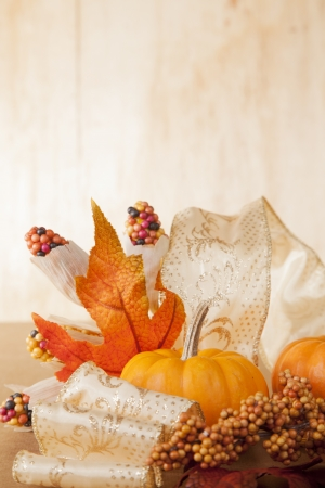 Warm colored fall items are arranged in a group and shot on a wooden background  photo