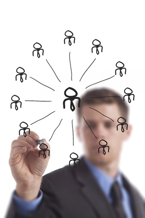 Young business man draws a networking group diagram.  Stock fotó
