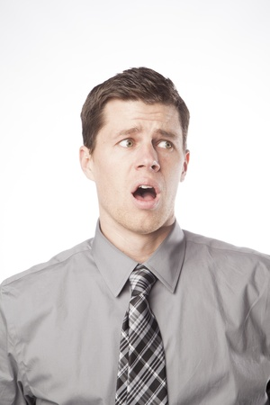 A young business professional opens his mouth in shock