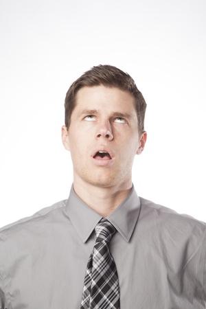Een jonge professional tot uitdrukking frustratie en verveling Stockfoto