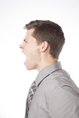 A young business professional screams loudly in frustration