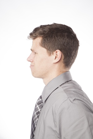 A young business professional looks off in confusion and frustration