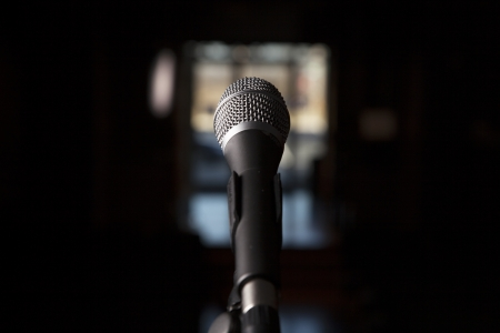 A microphone is shown alone with a blurred bocca background