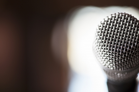 A macro shot of a silver microphone with light in the backround Stock fotó - 17631436