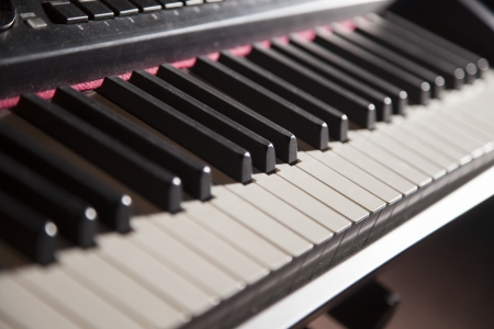 piano keys: A piano keyboard is shown close up and fades into the background  Stock Photo