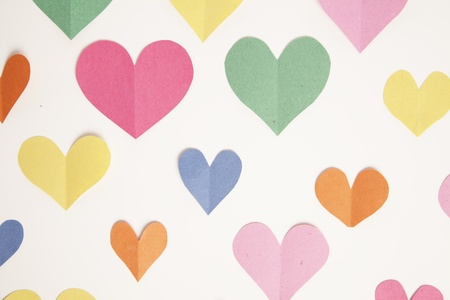 Cut out paper hearts from construction paper form a background  Stock fotó
