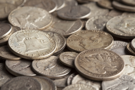 The Liberty Bell is shown on a coin pile with many other silver coins  Stock fotó
