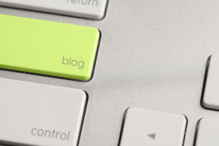 Highlighted blog button on computer keyboard.