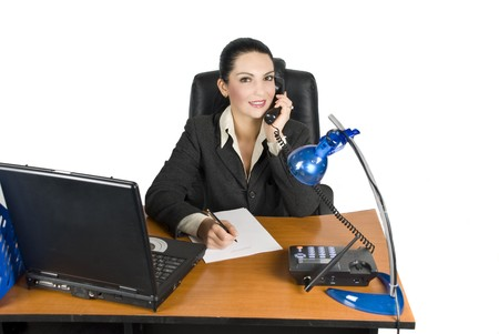 Business woman on the phone calling for business while write a agreement photo