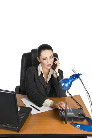 Business woman calling by telephone at office photo