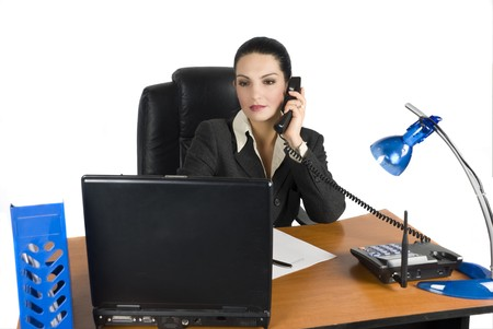 Business woman talking at phone and type on laptop photo