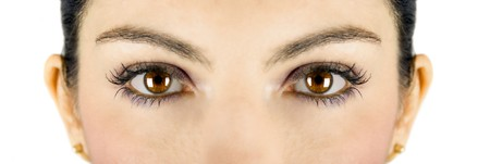 Beautiful brown woman eyes looking at you photo