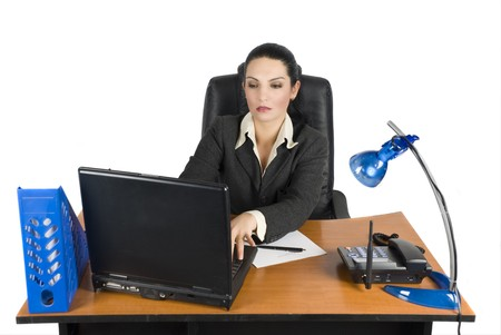 Business woman working on laptop at office photo