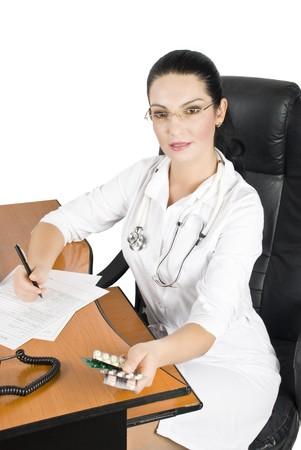 Female doctor make a medical prescription with pills photo