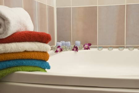 towel  spa  bathroom: Towels and candles  in a pink bathroom  Stock Photo