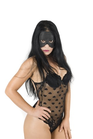 Sexy woman dressed in black lace outfit with hearts and mask face photo
