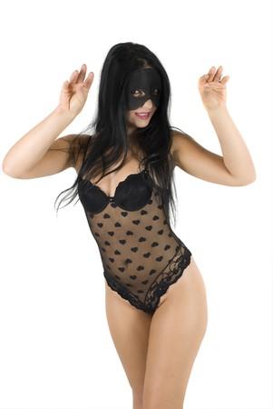 Female dressing in black underwear and wear a black mask on face posing in cat women photo
