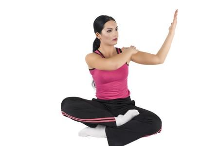Women doing yoga,lotus position on white background photo