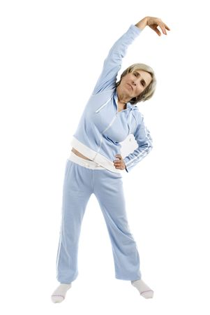 a year older: Cute mature woman doing sport dressed in a sport suit Stock Photo