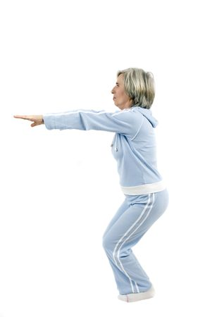 Active mature sportswoman doing some exercise for a healthy life photo