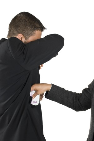 taker: Bribe taker and cover his face while take the money Stock Photo