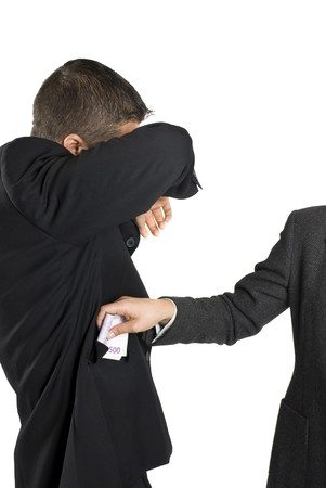 taker: Concept of corruption and bribe -Businessman take some bribe and hide his face