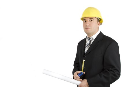 Young man engineer with yellow hardhat,ruler and project isolated on white background and copy space for text photo