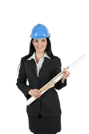 Young woman architect with blue hardhat and project photo