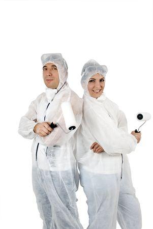 workingman: J�venes pintores feliz con rodillo de pintura aisladas sobre fondo blanco Foto de archivo