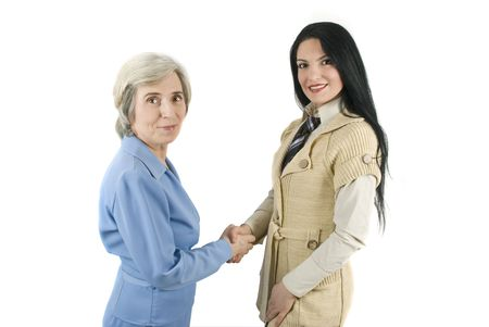 satisfactory: Two beautiful businesswoman,senior and young woman  make a satisfactory deal Stock Photo