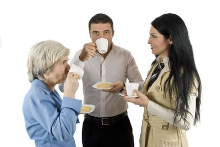 Three business people have a conversation and enjoy a hot coffee together photo