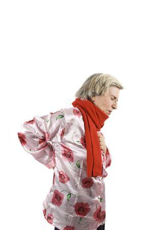 Senior woman having a back ache and a chest ache photo