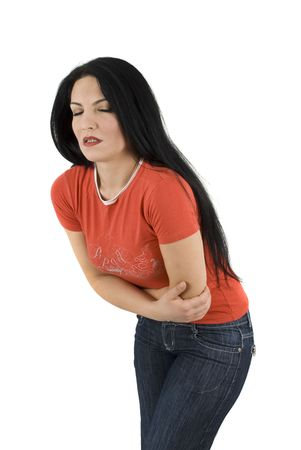 periods: Young woman having a bad stomach ache ,standing with hands crossed on pain  Stock Photo