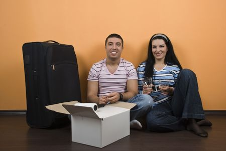 Young couple just moved in new house and prepare to celebrate together Stock Photo - 4256658