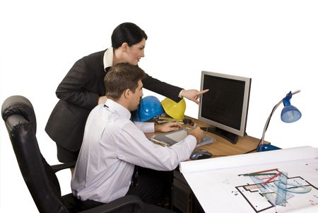 Young team of architects in office working,architect woman pointing on computer screen photo