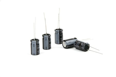 capacitors: Electronic component,few electrolytic capacitors isolated on white background Stock Photo
