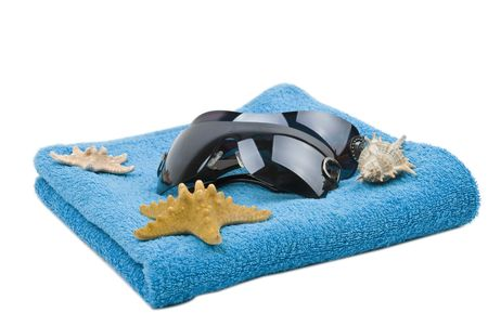 souvenirs: Blue towel ,sunglasses and starfish isolated on white background