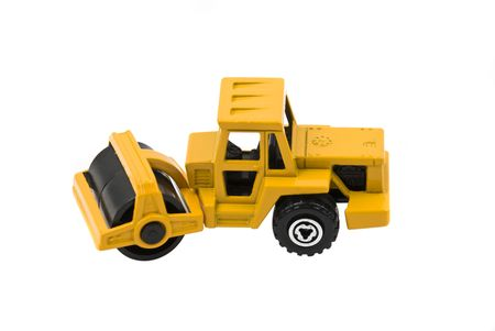 highroad: Vibratory soil or asphalt compactor yellow toy isolated on white background Stock Photo