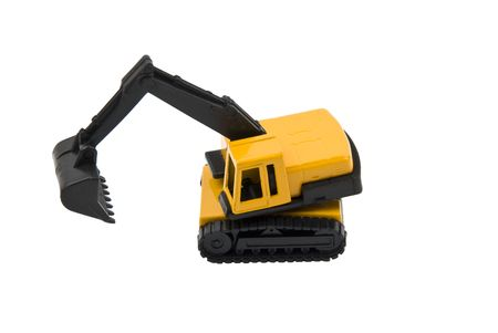 Small hydraulic excavator toy isolated on white background photo