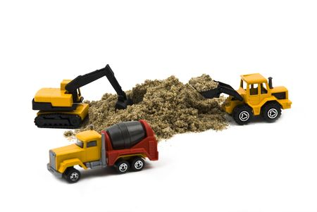 Machines miniature :cement mixer truck,wheel loader and hydraulic excavator working isolated on white background photo